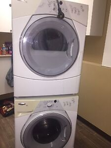 Whirlpool washer dryer with stacking kit.