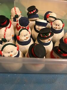 Snow men candle holders