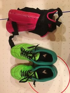 Soccer cleats and shin guards