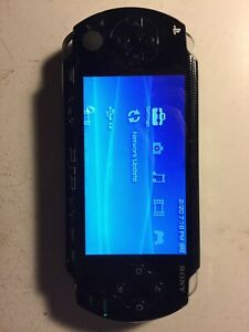 Sony PSP-1001 with charger