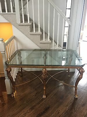 Elagant Glass cocktail table. Beveled Glass top. Antique brass finish.