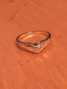 10k Gold white diamond ring $100