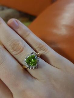 A Beautiful perridot and diamond 18k ring