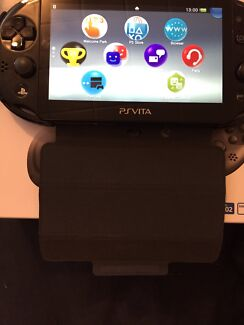 Ps vita 2000 with 8 gig memory card and 3 download tokens  Salisbury Salisbury Area Preview