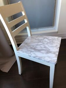 Marble wrapped dining set with four chairs