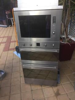 Oven wall double with matching microwave and extractor fan. SMEG.