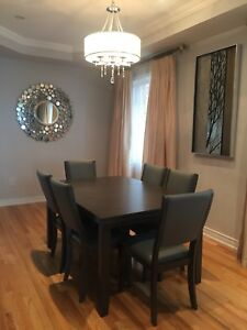 BRAND NEW SOLID WOOD DINING ROOM TABLE AND 6 LEATHER CHAIRS