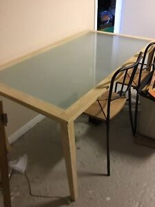 Pine IKEA table with glass center, and frameless shelf.