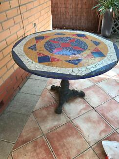 Outdoor mosaic table with solid  cast iron base