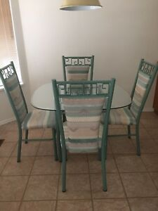 Glass kitchen table and 4 chairs very good condition