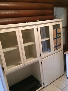 Cabinet with windows and shelves and cupboard and small table
