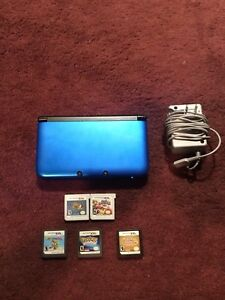 Blue Nindendo 3DS XL(works perfectly) Charger and 5 games