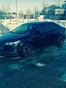 2011 blacked out Kia