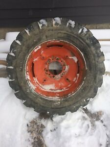 Skid steer tire and rim