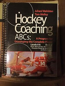 hockey coaching book & hockey sticks
