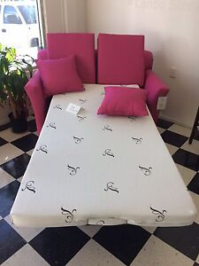 Hot pink single sofa bed.