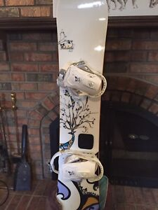 Women's Salomon snowboard, bindings and Burton boots