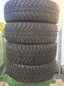 p235/60/18 inch Goodyear Winter Tires / LOTS OF TREAD