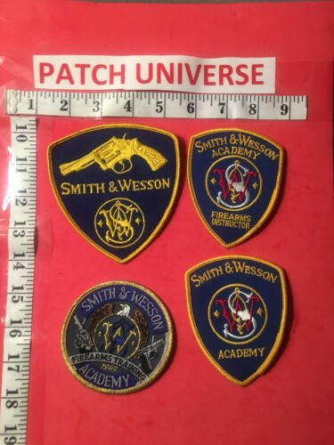 LOT OF 4 DIFF SMITH & WESSON ACADEMY/INSTRUCTOR  SHOULDER  PATCHES  H036
