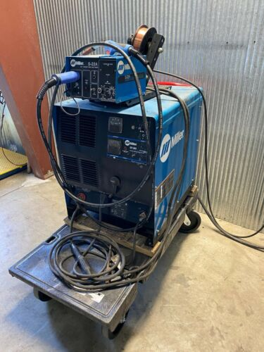 USED MILLER CP302 PACKAGE WITH 22A WIRE FEEDER