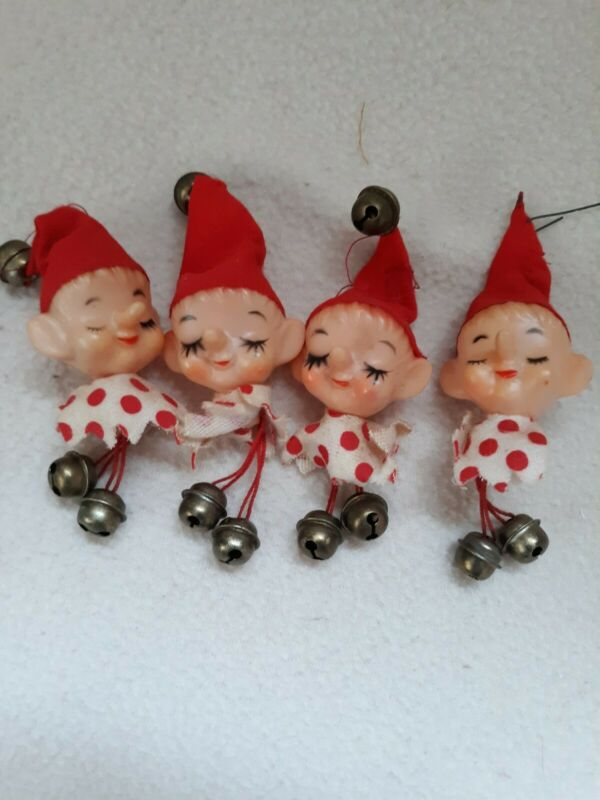 Four vintage elf head Christmas ornaments three inches long