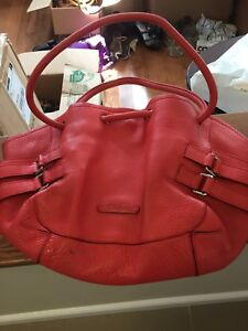 Coral leather Cole Haan large bag.  Gently used