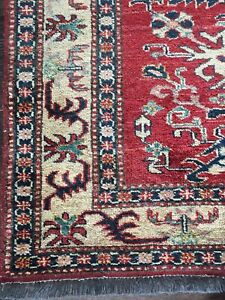 2 hand knotted rugs