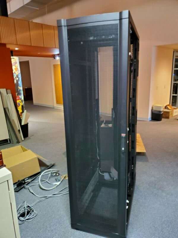 42U APC AR3100 Server Rack Cabinet Open on right side with 2 Smart-UPS