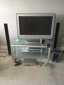 Plasma tv home theatre, CD player, and wireless speakers