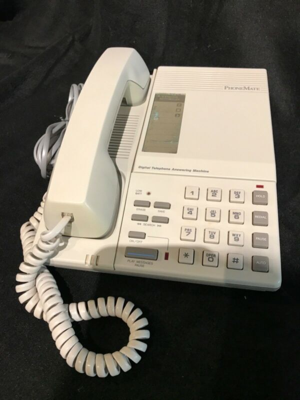 Vintage push button phone with cassette tape answering machine