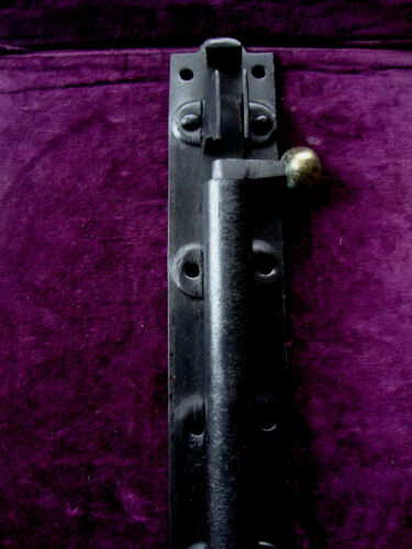 Very large antique iron and brass security door bolt and keep