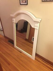Solid wood mirror.