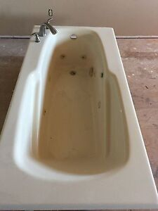 Jetted bathtub with faucet for sale