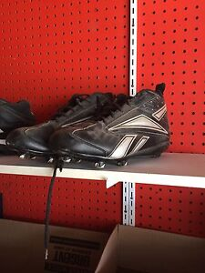 3 pairs of foot ball cleats