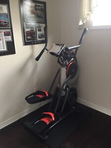 Bowflex Max trainer M5 brand new with floor protecting Mat