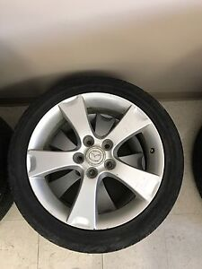 2 Mazda rims with tires