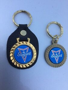 Vintage GM Pontiac Sunbird New keychains. 5$for the pair!