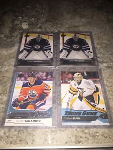 Big lot of young guns hockey cards and jersey cards.