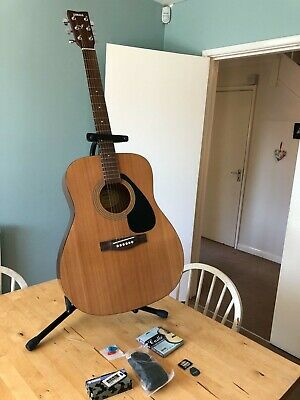 Yamaha F310 Acoustic Guitar, with spare strings, stand, strap and tuner.