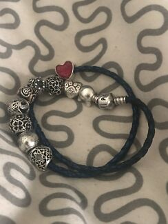 Pandora leather bracelet with charms.