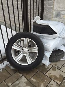 4 AUTHENTIC DODGE RAM RIMS (come with the tires)
