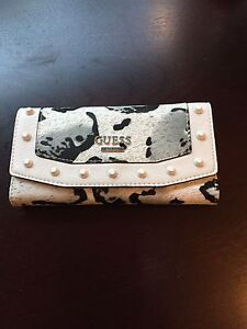 Wallet and 4 purses swipe page starting at 35.00 up to 250.