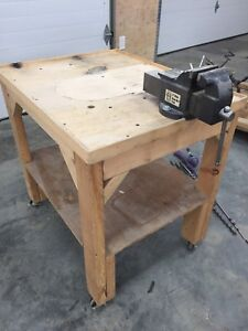 Wooden table with Vise