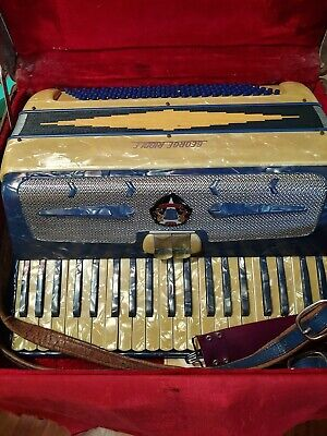 1960s George Riddle accordion with original case and sheet music.