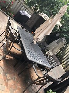 Aluminum patio table with 6 chairs and umbrella