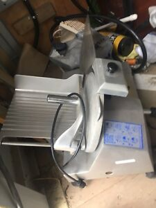 Commercial deli slicer and large all American pressure canner.