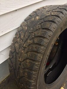 One  winter studded tire 215/60/R17
