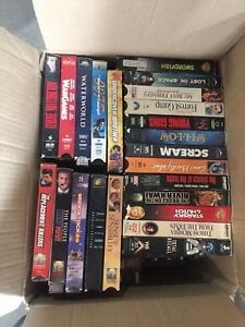 VHS collection plus unopened DVDs