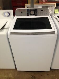 1 year old Kenmore washer glass top