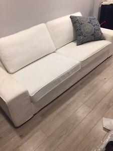 Cream white slip cover sofa